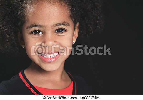 Portrait of a cute african american little boy, isolated on blac - csp39247494