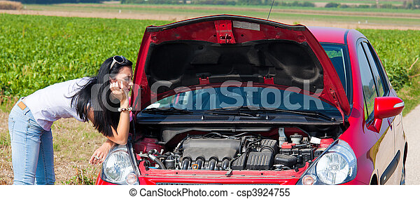 Woman has in her car breaks down. Engine failure - csp3924755