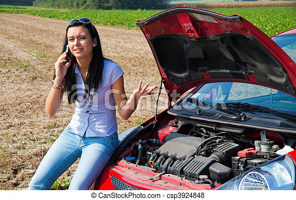 Woman has in her car breaks down. Engine failure