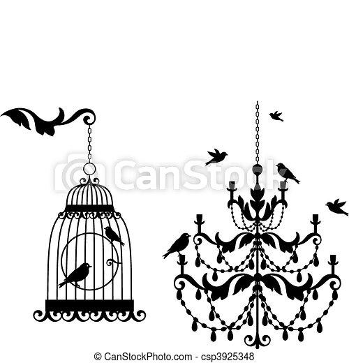 antique birdcage and chandelier - csp3925348
