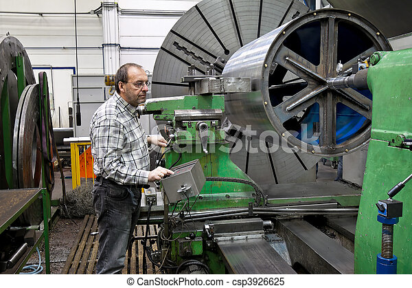 Older workers in the metal industry in CNC milling machine. - csp3926625