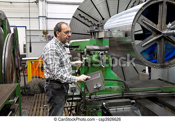Older workers in the metal industry in CNC milling machine. - csp3926626