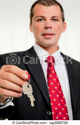 Real estate broker with a house key - csp3926728