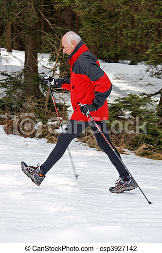 Senior Nordic Walking in winter - csp3927142