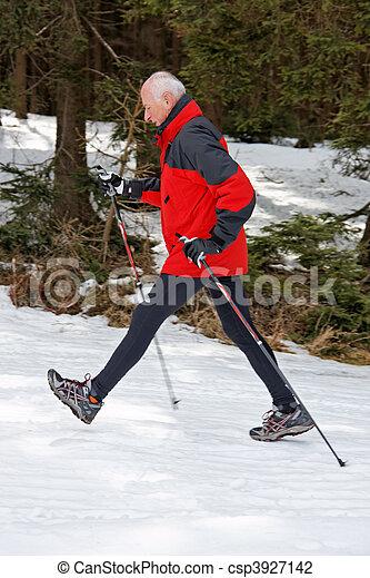 Senior Nordic Walking in winter - csp3927142