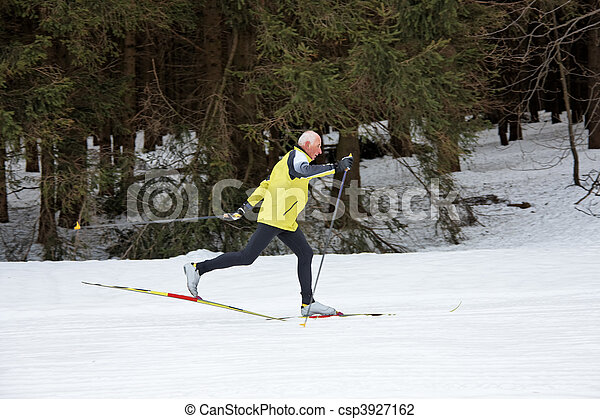 Senior cross country skiing during the winter - csp3927162
