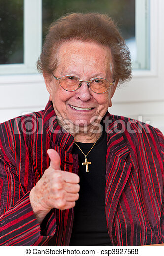 Successful senior citizen laughs with thumbs up - csp3927568