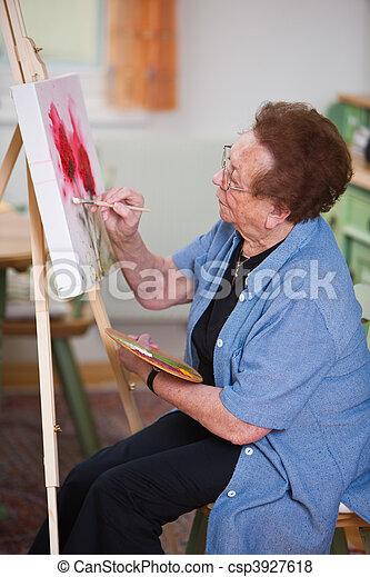 Active senior citizen paints a picture in Sports - csp3927618