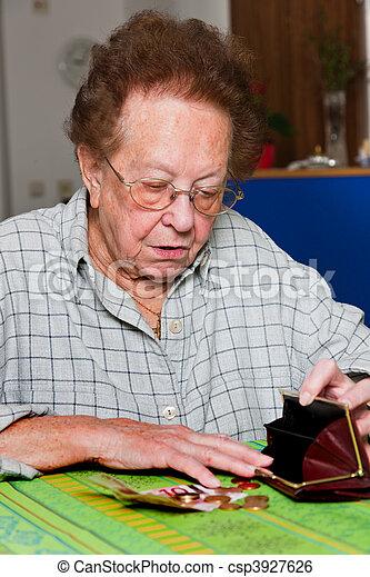 Senior citizen counts their money from pension - csp3927626
