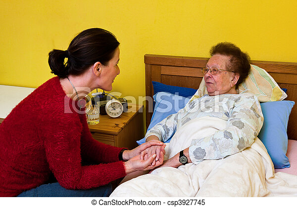 Sick old woman is visited by - csp3927745
