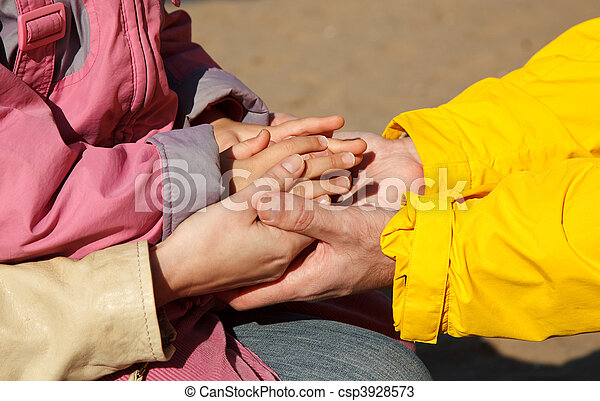 United hands of adults and child as symbol of family unity. Photo outdoors. - csp3928573