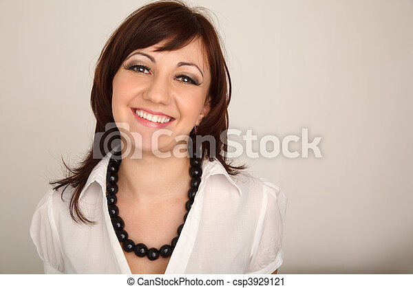Portrait of smiling girl in white shirt against white wall. Horizontal format. - csp3929121