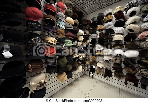 Caps, winter caps, hats, berets and other headdress on wall in shop - csp3929203