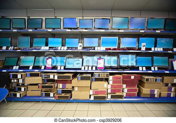 Rack with liquid crystal displays and monitors in electronics shop - csp3929206