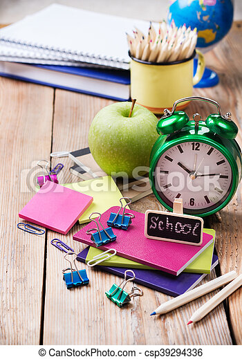 Business, education, office still life concept. School accessories, supplies, mug with pencils, alarm clock on rustic wooden table. Selective focus