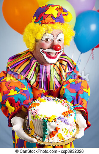 Happy birthday clown holding a birthday cake. Cake is ready for your text.