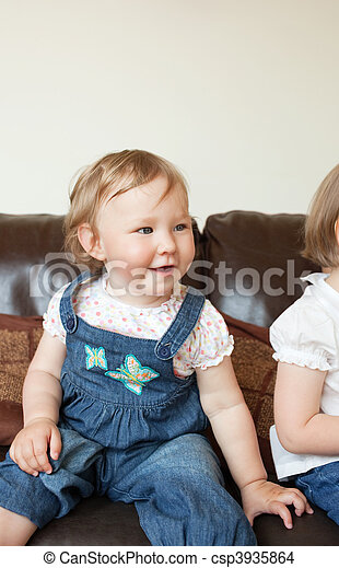 Smiling girl sitting on the sofa - csp3935864