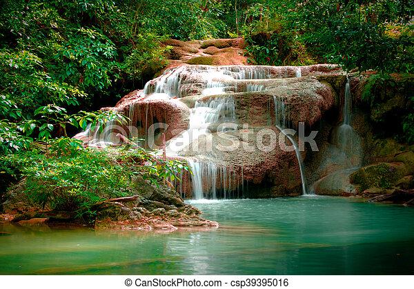 Erawan waterfall in Thailand in deep forest - csp39395016