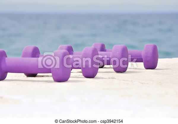 Dumb bells on the beach - csp3942154