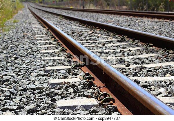 iron rusty train railway detail over dark stones - csp3947737