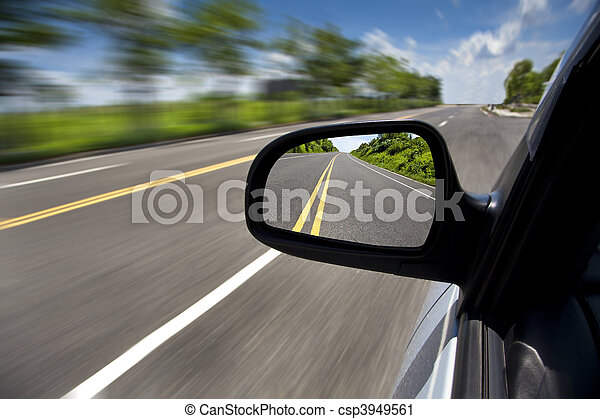 car driving through the empty road and focus on mirror - csp3949561