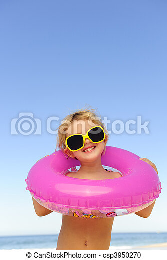 child with sunglasses and inflatable ring at the beach - csp3950270