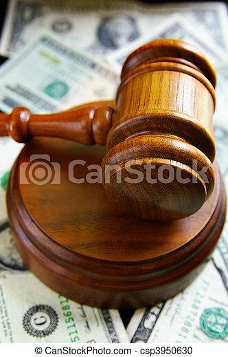 closeup of judges court gavel, over american money - csp3950630