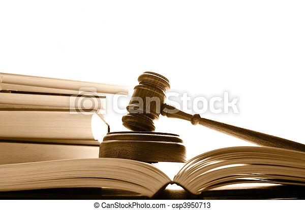judges court gavel on law books, over white - csp3950713