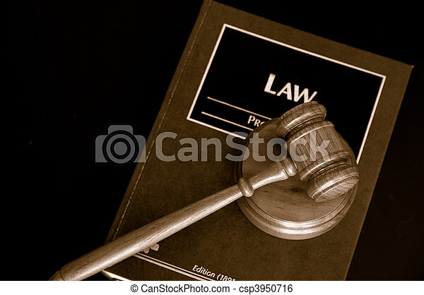 judges court gavel on a law book, from above - csp3950716
