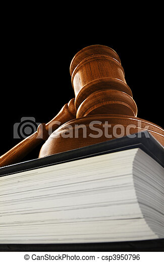 judge\'s court gavel on a law book, on black - csp3950796