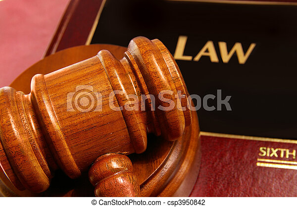 law book and judges gavel closeup from above - csp3950842