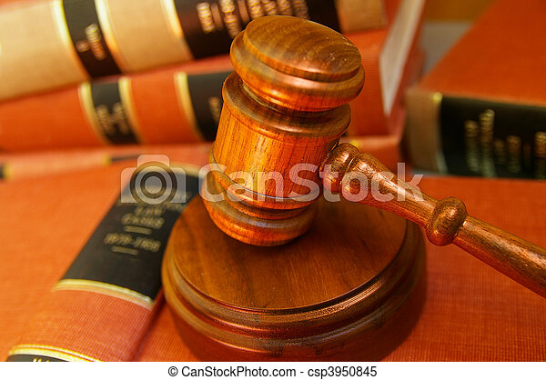 Judges gavel on a pile of law books - csp3950845