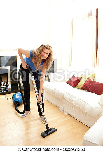 Smiling woman use vacuum cleaner - csp3951360