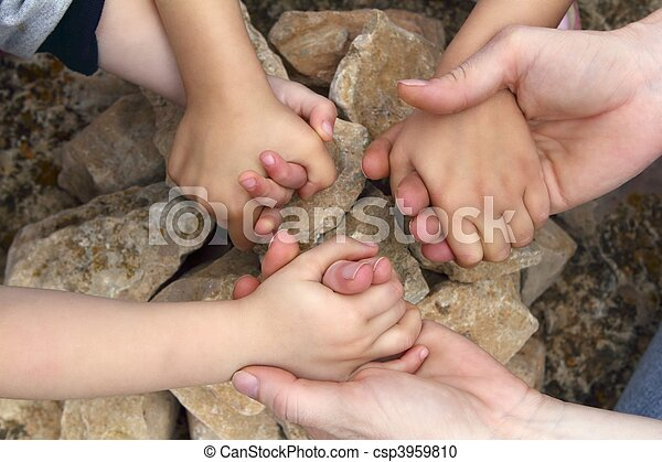 adult and chilcren holding hands stone circle - csp3959810