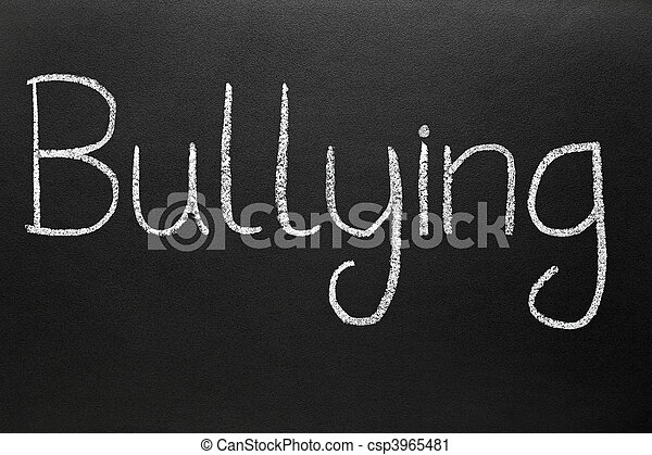 Bullying, written with white chalk on a blackboard. - csp3965481