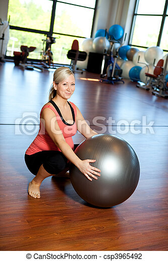 Pregnant women doing squatting exercise. - csp3965492