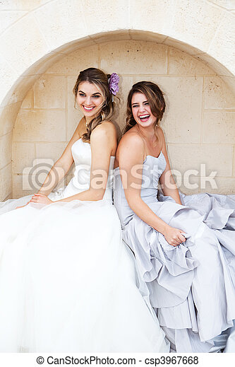 Young Women in Gowns and Sitting in an Alcove - csp3967668