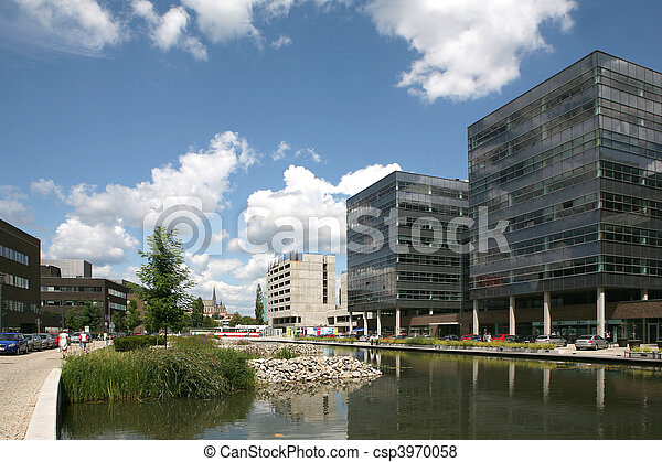 New modern futuristic buildings and blue skyes in cloudy day - csp3970058
