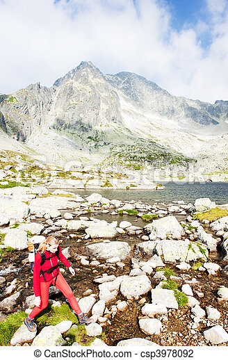 woman backpacker at Five Spis Tarns, Vysoke Tatry (High Tatras), Slovakia - csp3978092