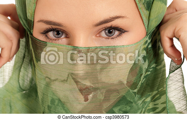 Young arab woman with veil showing her eyes isolated on white background - csp3980573