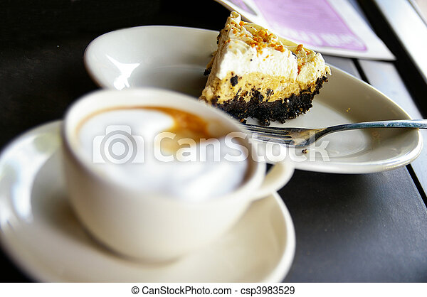 Cup of  frothy coffee and cake, cake is sharp - csp3983529