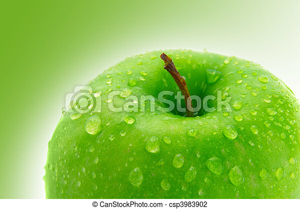 Top of a crisp green apple with water droplets - csp3983902