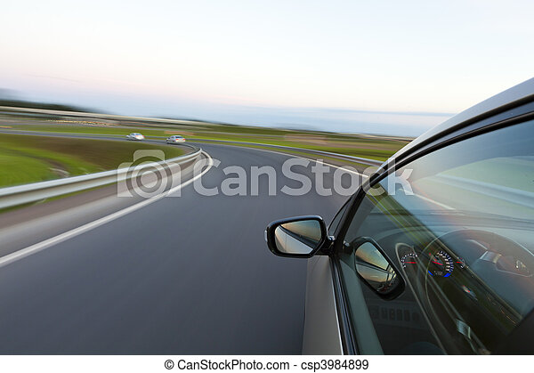 Car goes very fast to turn a country road - csp3984899