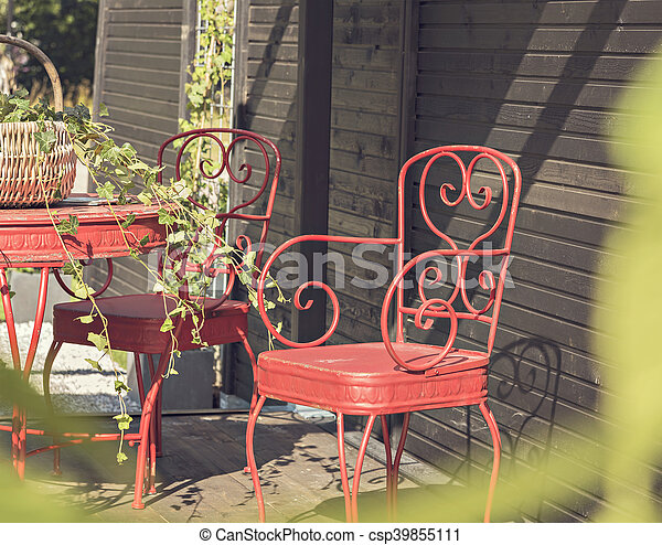 Image of elegant red patio furniture.
