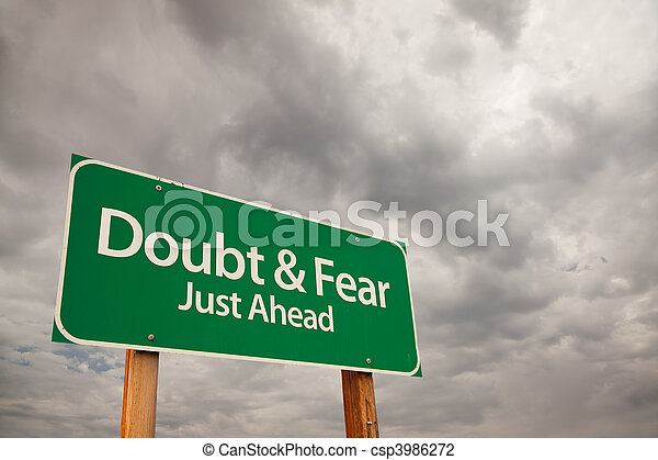 Doubt and Fear Green Road Sign Over Storm Clouds - csp3986272