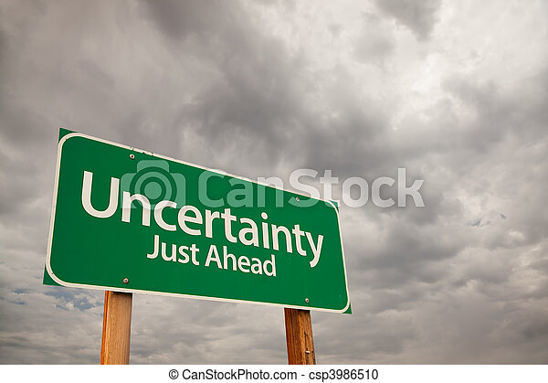 Uncertainty Green Road Sign Over Storm Clouds - csp3986510
