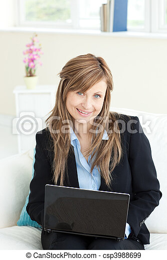 Sophisticated businesswoman using her laptop - csp3988699