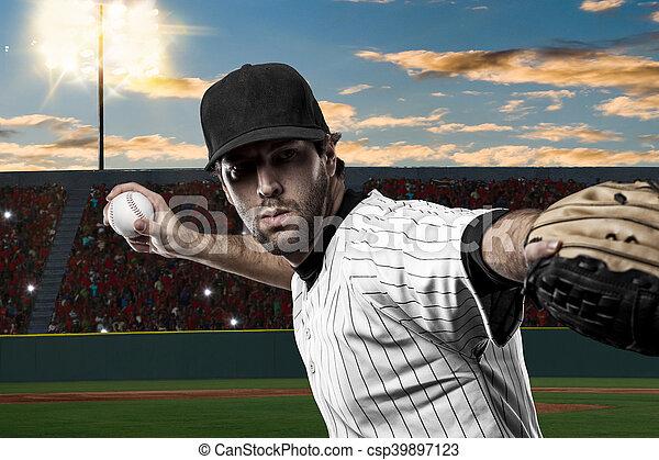 Baseball Player with a white uniform on baseball Stadium.