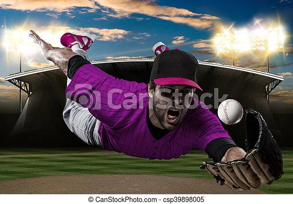Baseball Player with a pink uniform on baseball Stadium.