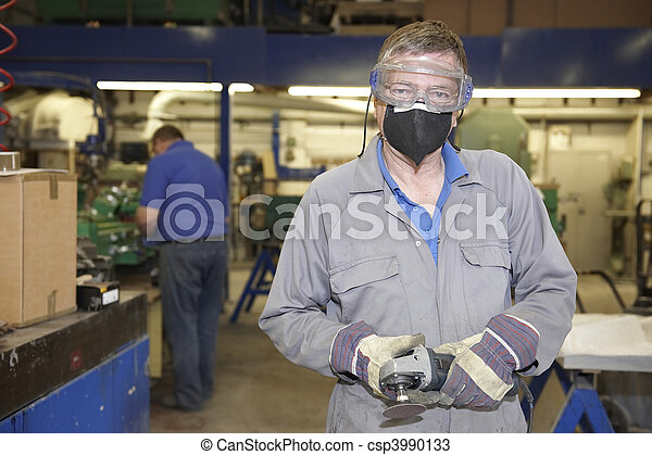 Worker with angle grinder - csp3990133